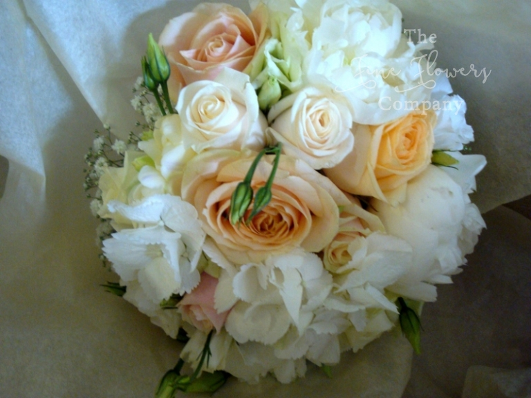gypsophila wedding - bridal bouquet of peach rose,s hydrangea, lisianthus and gypsophila
