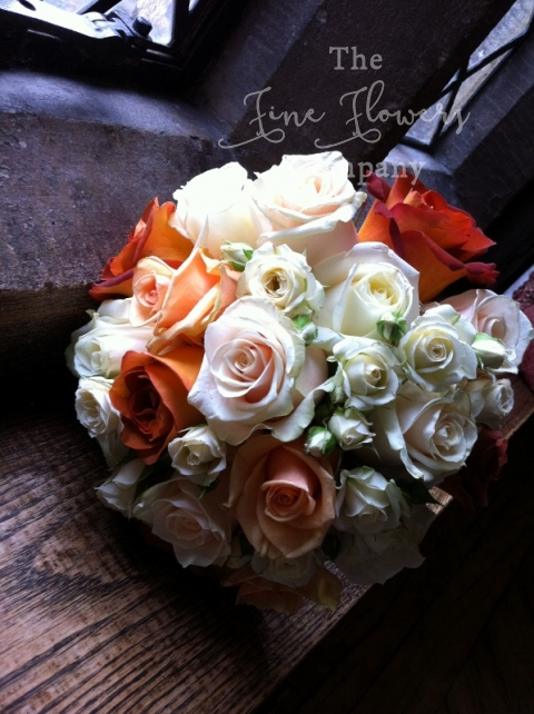 Great Fosters autumn wedding - bridesmaids bouquet of ivory, cream, peach and burnt orange roses
