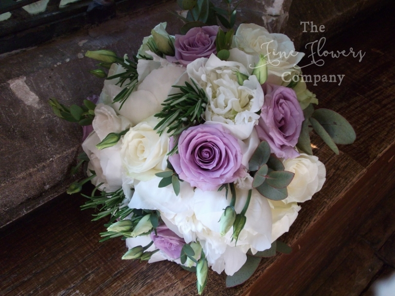 ivory roses, paeonies and lilac Pacific blue roses bridal bouquet,with scented herbs, from Great Fosters wedding