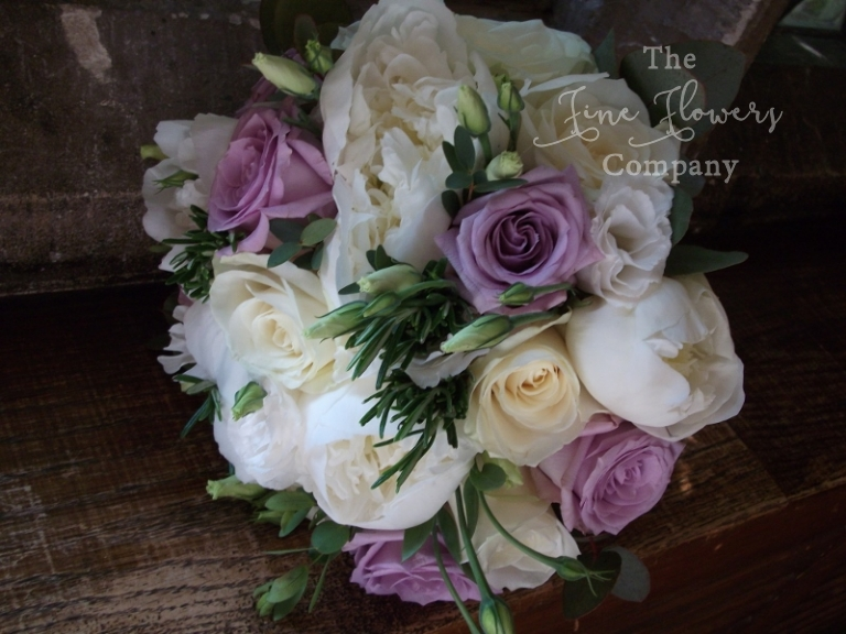 ivory & lilac wedding flowers - bridal bouquet with lilac Pacific Blue roses and ivory paeonies and roses.