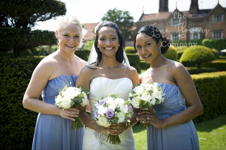Ivory & lilac wedding flowers - bridal and bridesmaids bouquets, from Great Fosters wedding