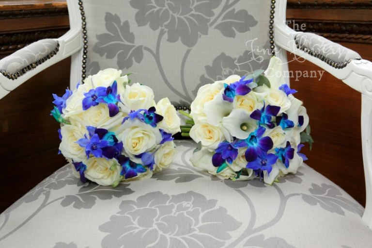 bridal bouquet of ivory roses, calla lilies and blue singapore orchids. Berkshire wedding at Monkey Island