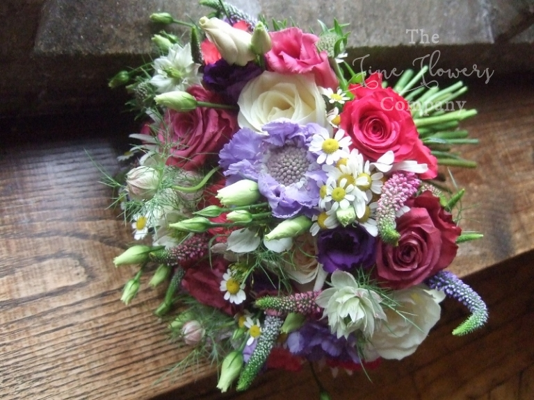 wildflowers bridal bouquet with roses, daisies, lilac scabiosa, nigella, lisianthsu and herbs from Great Fosters wedding in Egham