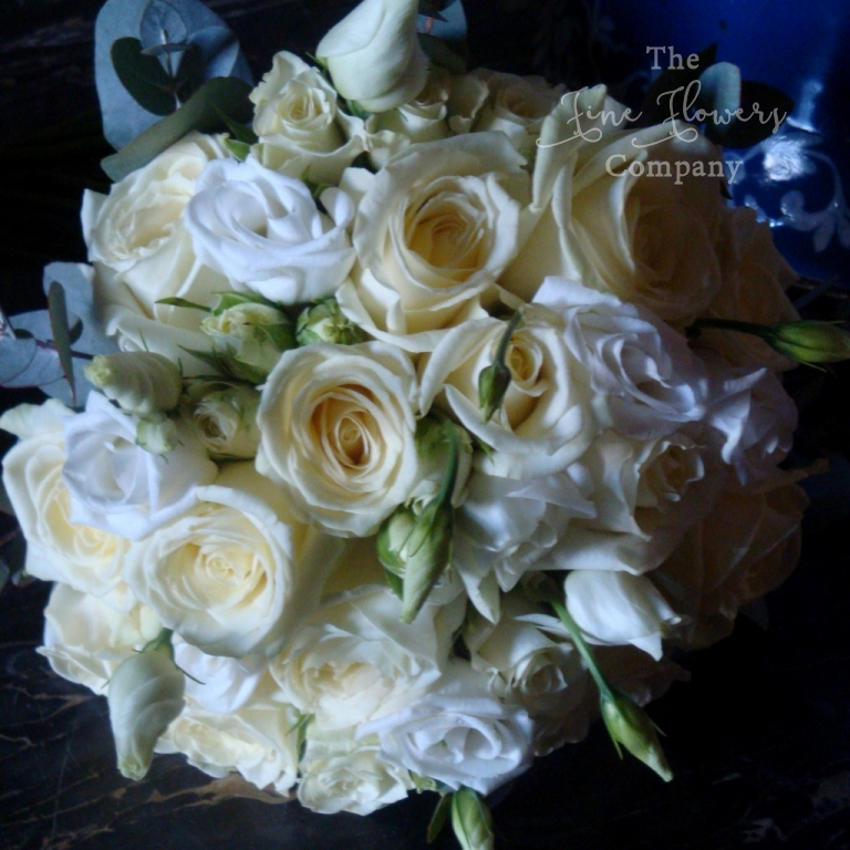 bridesmaids bouquet of Avalanche roses, lisianthus and spray roses from winter Highclere Castle wedding
