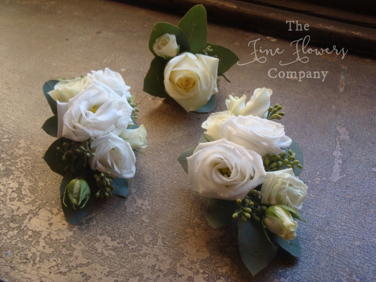 corsages of ivory lisianthus from winter Highclere Castle wedding