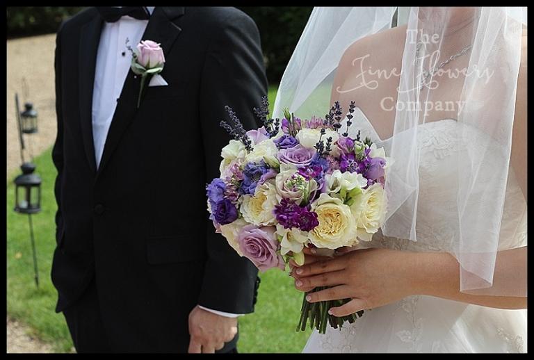 Bridal handtied bouquet of ivory Avalanche roses, lilac Pacific Blue roses, David Austin Patience garden scented roses, lilac scabios, freesias, lilac lisianthus with lavender sprigs. From wedding at Hampton Court House. HCH bridal flowers. Surrey west london wedding flowers