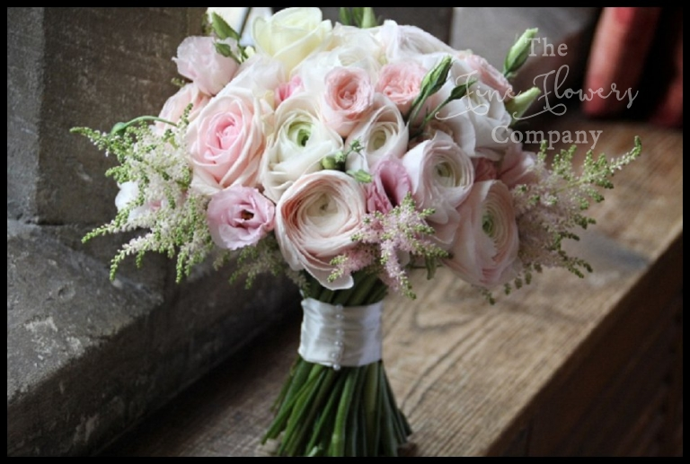 spring bridal bouquet of blush ranunculus, O'Hara roses, lisianthus and astilbe.
