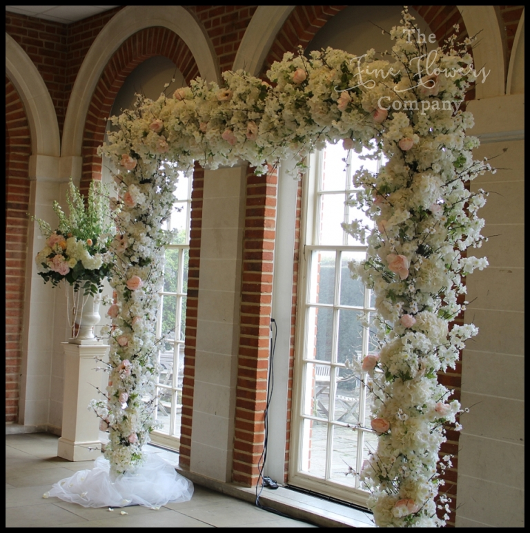 Wedding flowers arch hire the fine flower company blossom flower tree arch with cherry blossom hydrangeas and blush paeonies from wedding ceremony junglespirit Images