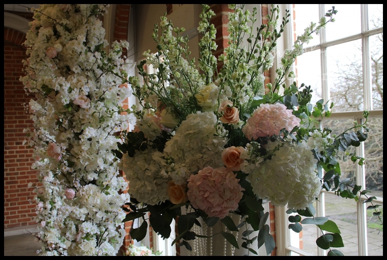 Wedding flowers arch hire the fine flower company dramatic ceremony centrepiece of ivory and blush and peach wedding flowers mightylinksfo