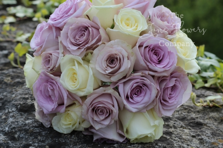 Bridal bouquet ideas, ivory and lilac roses, from Coworth Park wedding