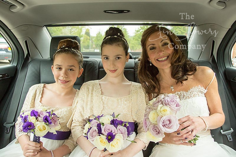 Coworth Park wedding flowers - bridal and bridesmaids bouquets of ivory, lilac and deep purple.