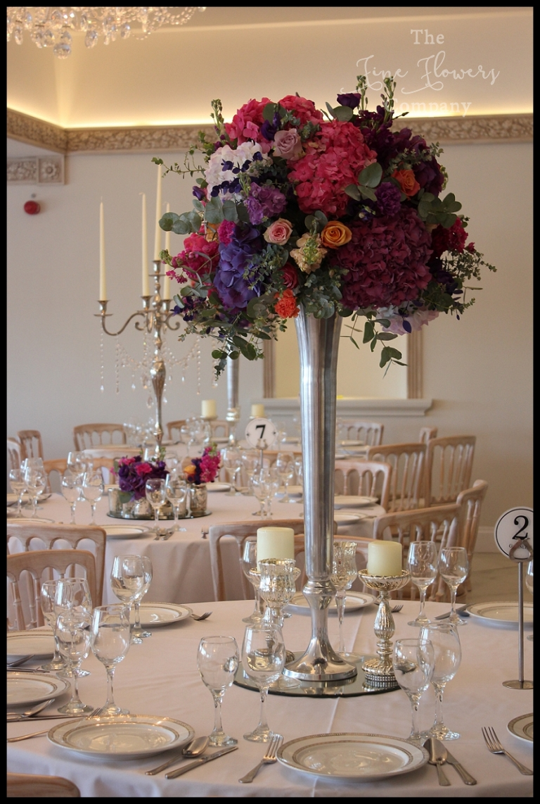 Froyle park wedding flowers the fine flower company tall vibrant colourfull bright wedding floers table centrepiece in a tall silver vase from froyle izmirmasajfo
