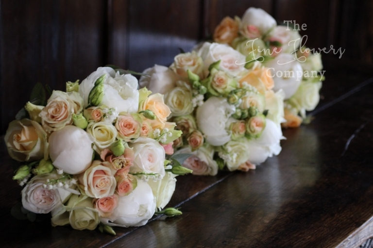 Bridesmaids Bouquets Of Ivory And Peach Roses Paeonies Lisianthus Lily The Valley