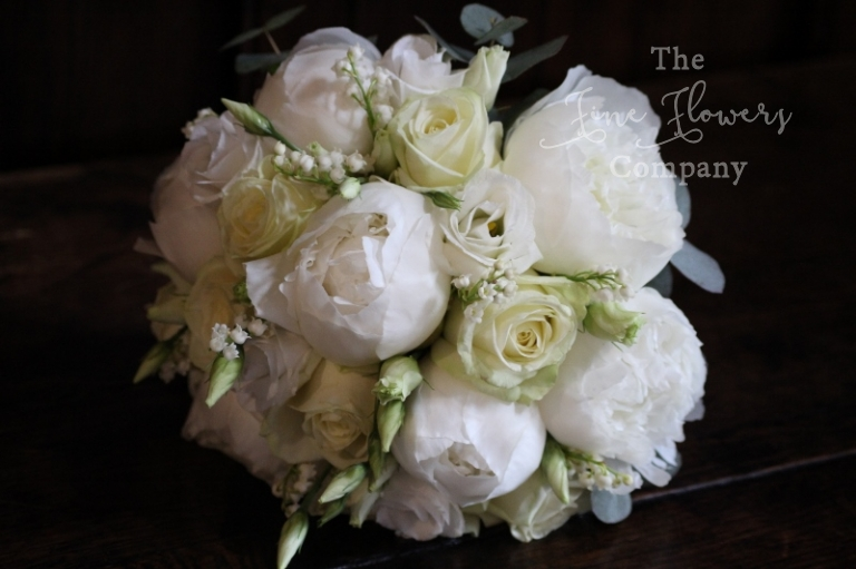 bridal bouquet of roses, paeonies, lisianthus and lily of the valley, Surrey florist. From Great Fosters wedding