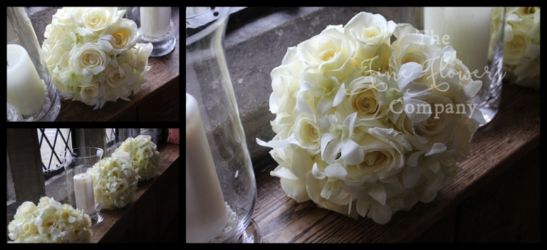 bride bridesmaids handtied boquuet of ivory white avalanche roses and dainty singapore orchids