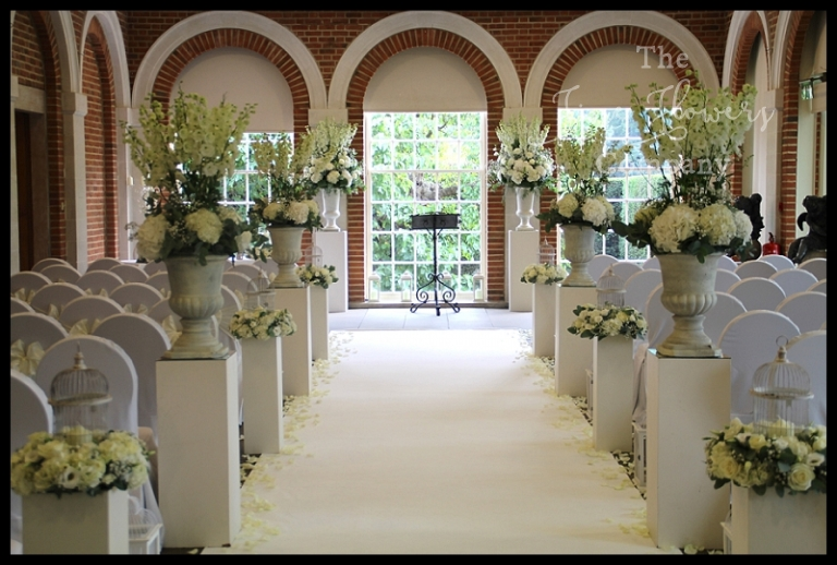 Great Fosters white wedding ceremony, great fosters wedding aisle runner, great fosters wedding ceremony flowers, great fosters white ivory wedding flowers, Great Fosters Orangery photos, Great Fosters wedding photography, wedding aisle ideas, urns with flowers down the aisle,