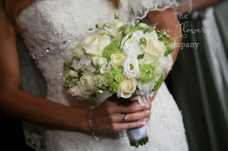 bridal bouquet of ivory roses, ivory lisianthus, green vibernum, from Great Fosters wedding in Surrey