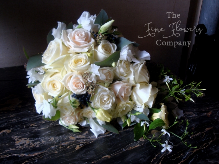Highclere Castle wedding - bridal bouquet in ivory and royal navy blue, using roses and vibernum, Highclere recommended florist