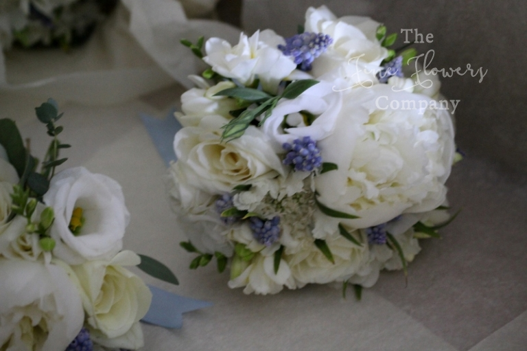 ivory and blue flower girls posies from Polesden Lacey wedding