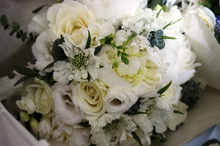ivory bridal bouquet of paeonies, scented roses, scabios, freesias and lisianthus from Polesden Lacey wedding