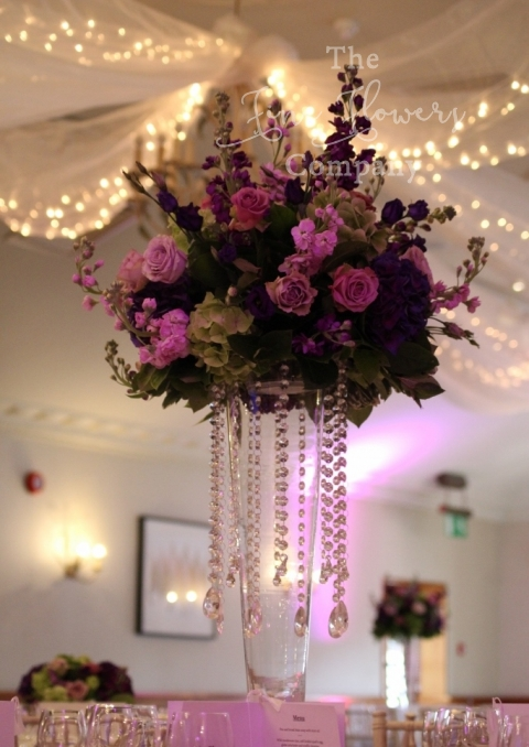 pennyhill park wedding crystal centrepieces in rich purple, lime green and pinks.