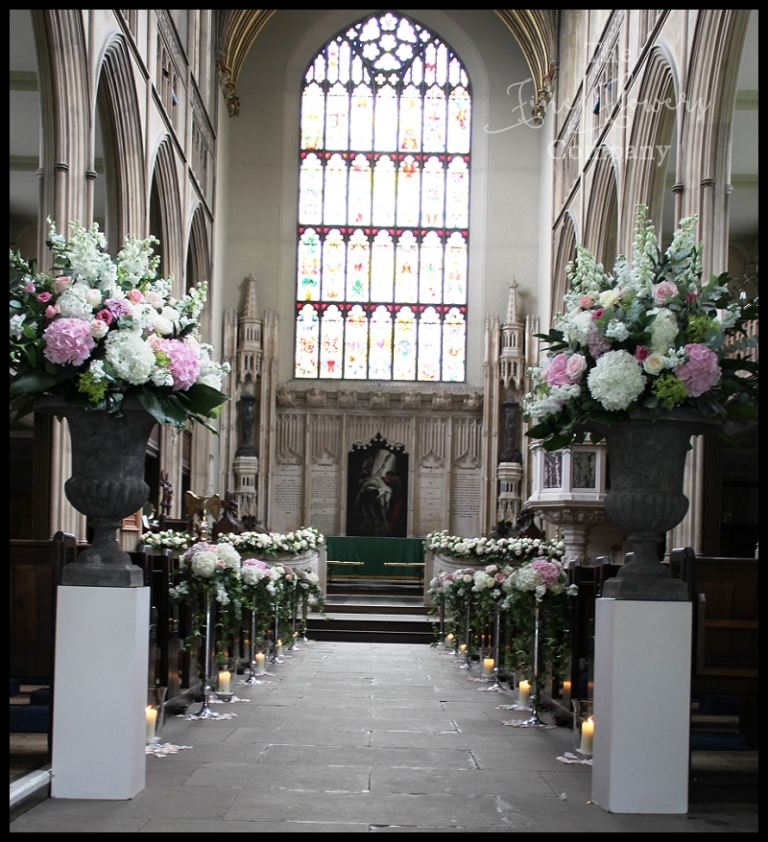 dt lukes church chelsea wedding, church wedding flowers, church wedding aisle with flowers, candles and rose petals scatter. chelsea wedding florist