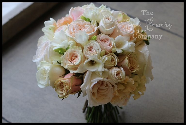 ivory cream blush bridal bouquet with roses, freesias and spray roses.