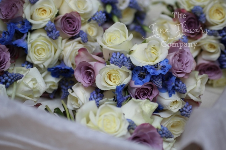 ivory, blue and vintage pink lilac bouquets wedding flowers from Cain Manor wedding in Hampshire