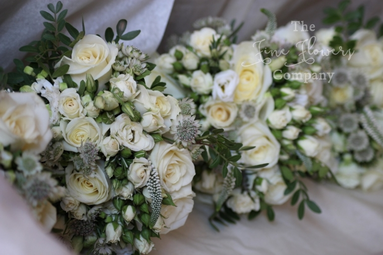 Wild just picked bridesmaids bouquets, Ascot wedding flowers. From Coworth Park wedding reception