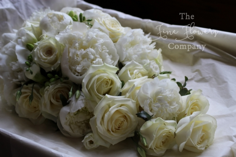 bridal tear drop bouquet of ivory Avalanche roses and paeonies, from Horsley Towers wedding, Surrey