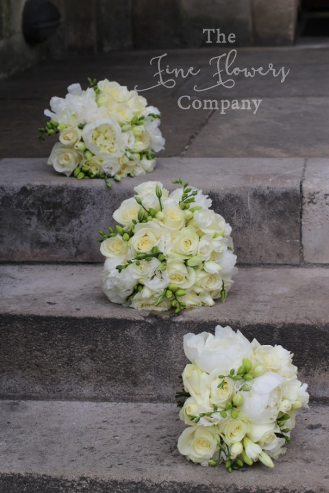 Bridesmaids bouquets of ivory Avalanche roses, paeonies, lisianthus and freesias, from Horsley Towers wedding, Surrey