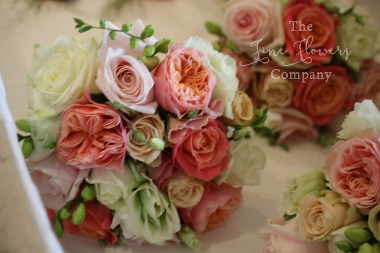 coral peach and pink bridal flowers wedding flowers