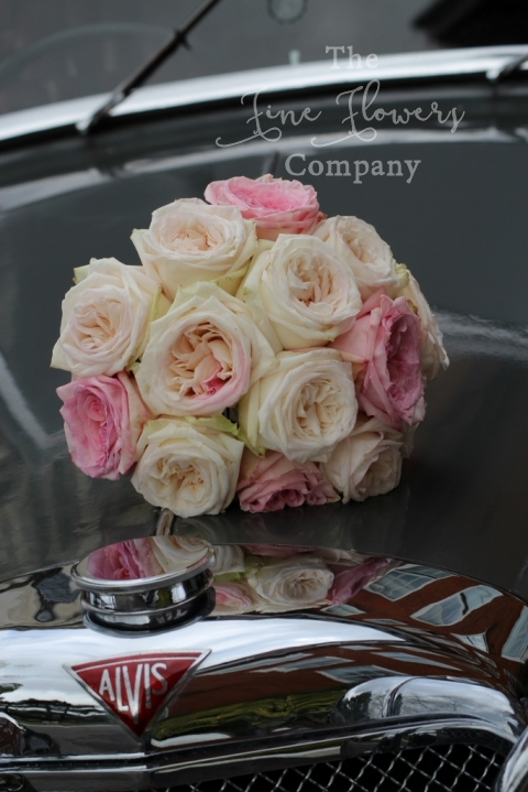 Bridal bouquet of Pink O'Hara and White O'Hara roses from Hampton Court House wedding