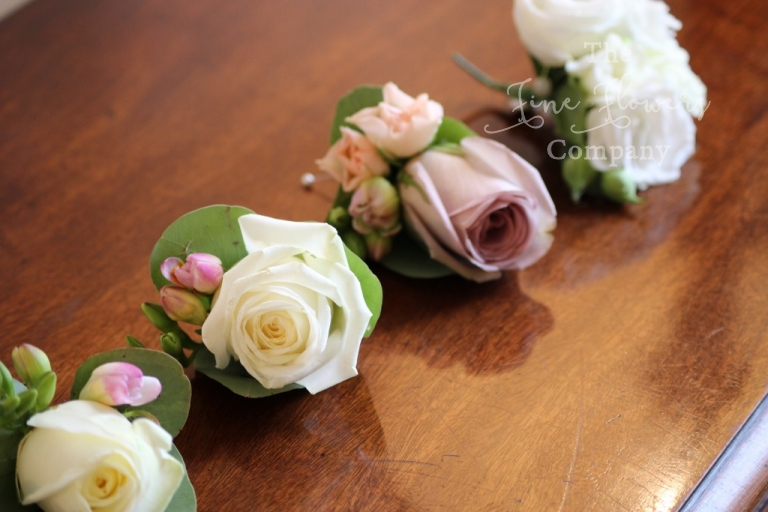 rose buttonholes from Botleys Mansion wedding reception