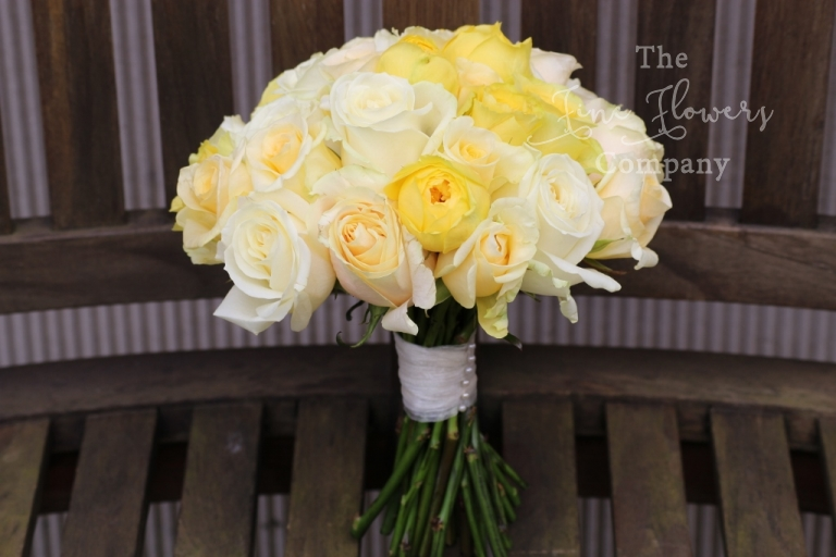 ivory, cream and lemon roses bouquet - Surrey wedding florist