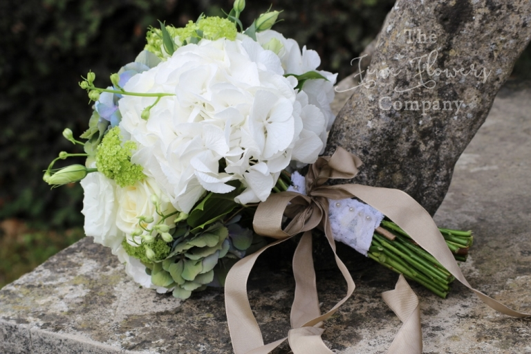 Bridal bouquet of white hydrangeas, green vibernum, white lisianthsu and roses from Surrey wedding florist