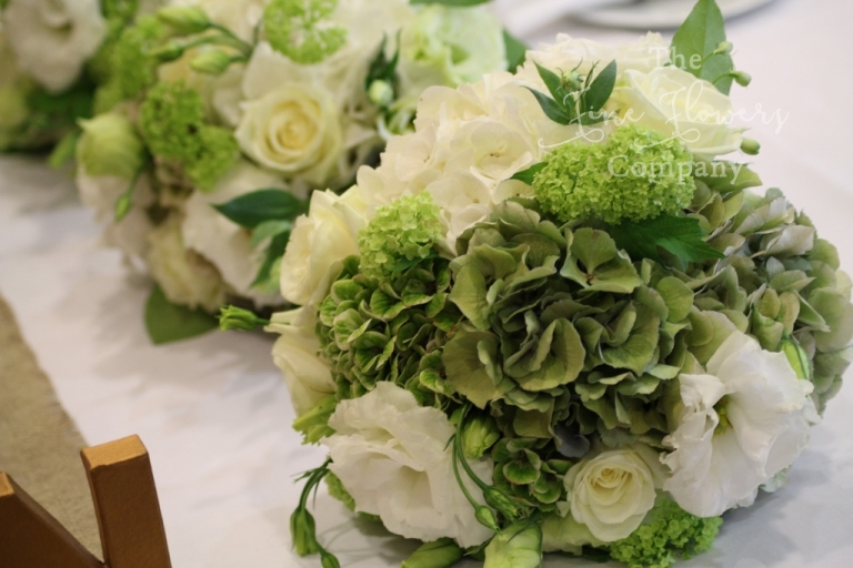 wedding bouquets of green and white hydrangeas, roses and lisianthus from Great Fosters wedding