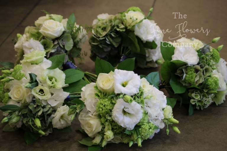 bridesmaids wedding bouquets of green and white hydrangeas, ivory lisianthus, green vibernum and roses, from Great Fosters wedding florist