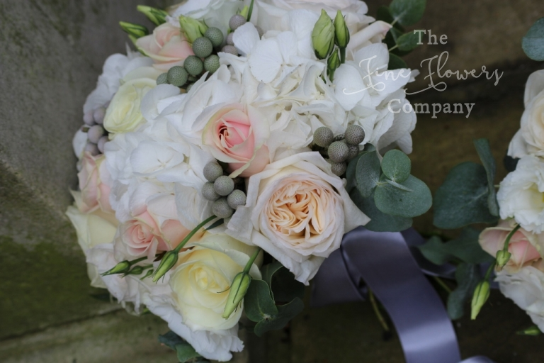 vintage bouquet of ivory and blush pink, with O'Hara garden roses, hydrangeas, silvery brunnia berries