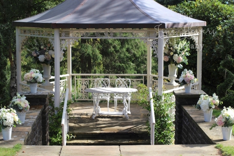 pennyhill park outdoor wedding ceremony flowers, pavilion wedding flowers at pennyhill park, pennyhill park florist