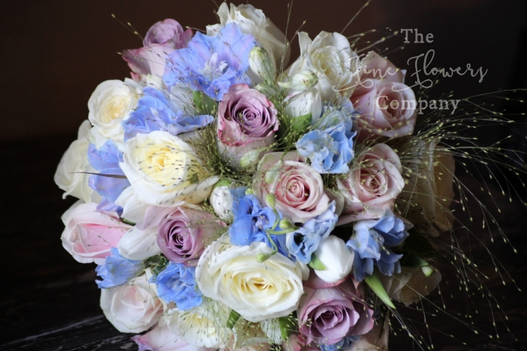 Berkshire bride - bridal bouquet of ivory and dusky pink roses and pale blue delphiniums, from recent wedding at Highclere Castle.