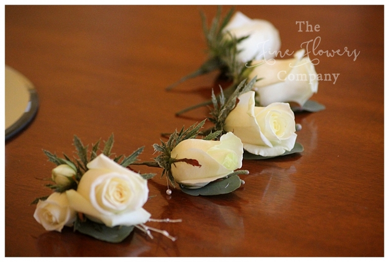 white rose and sparkly white twigs buttonholes