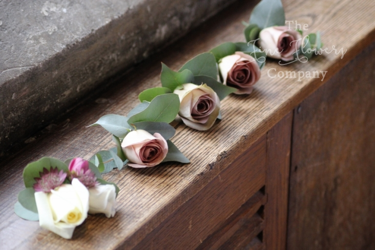 dusky pink buttonholes from recent wedding at Great Fosters