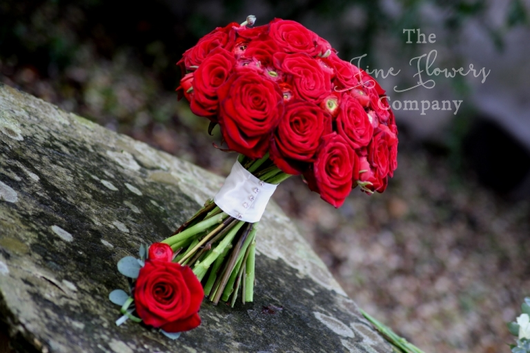 bridal bouquet surrey - deep red Grand Prix roses and red ranunculus