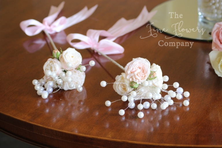 flowers girls flower wands with spray roses and pearls.