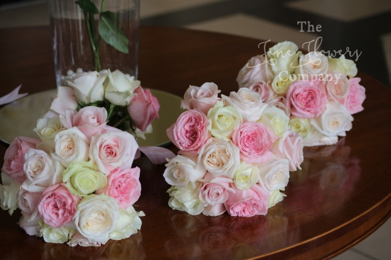 bridal flowers at Botleys Mansion wedding - handtied bouquets of ivory and pink roses, O'Hara roses and Sweet Avalanche roses bouquet