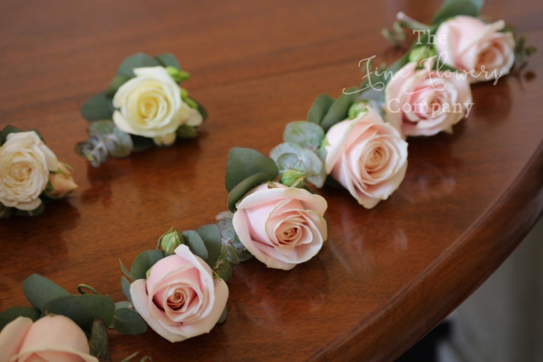 blush pink mens buttonholes of Sweet Avalanche roses and eucalyptus, from recent Botkleys Mansion wedding