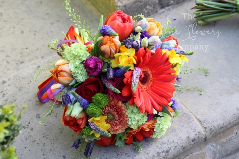red, purpel, orange, bridal bouquet of spring flowers