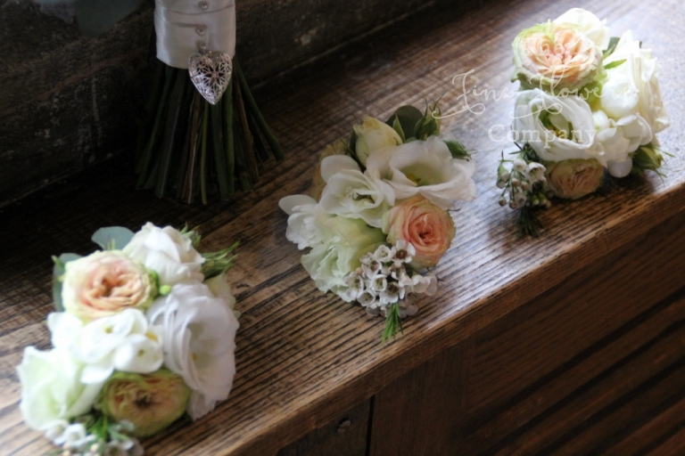 ivory and cream spray rose corsages with wax flowers, from wedding at Great Fosters
