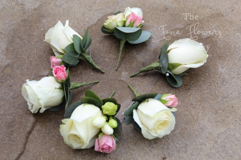 buttonholes of ivory Avalanche roses with blush pink spray roses, bridal flowers berkshire